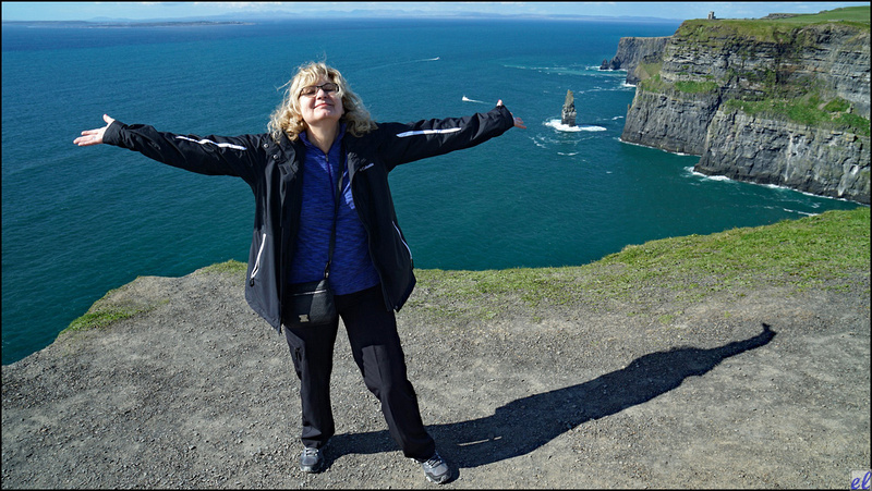Karen Thompson, my sister and fellow traveler, at the Cliffs of Moher