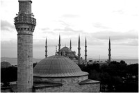 Sultan Ahmed Mosque in background. Minaret and dome of Firuz Aga Mosque in foreground.