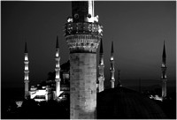 Sultan Ahmed Mosque in background. Minaret of Firuz Aga Mosque in foreground.